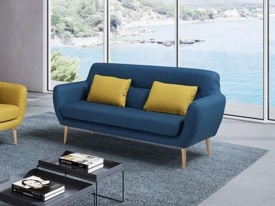 divano blu con due cuscini gialli ditta di pulizie roma